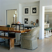 In the dining room the table has been constructed with planks laid on industrial bases with the informal look continuing in the mismatched chairs and antique bench