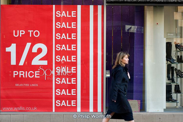 Pre-Christmas sale at Wallis shoe shop, Moorgate, London.