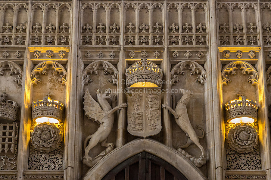 UK, England, Cambridge.  King's College Chapel, Symbols of Royalty.  From left to right: Crown and Tudor Rose;  Cadwallader, the Red Dragon of Wales; Coat of Arms including the French fleur-de-lys; Greyhound, symbol of the Beaufort Family; Crown and Rose.