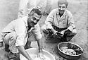 Iraq 1960 .Sheikh Marouf Barzinji, in jail in Bagdhad, washing his clothes.Irak 1960.Bagdad: Marouf Barzinji lavant ses affaires en prison ( 11 novembre 1960 )