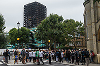 Survivors of the Grenfell Tower disaster hold a silent march and vigil two months after the fire to remember the dead and demand justice. West London 14-8-17
