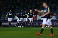 23rd February 2021; Kenilworth Road, Luton, Bedfordshire, England; English Football League Championship Football, Luton Town versus Millwall; George Evans of Millwall celebrates with team mates as he scores for 1-1 in injury time