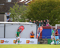 Cork City fans, watching from the top of a wall, react after their side have a chance to score.<br /> <br /> Cobh Ramblers v Cork City, SSE Airtricity League Division 1, 28/5/21, St. Colman's Park, Cobh.<br /> <br /> Copyright Steve Alfred 2021.