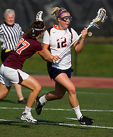 Charlie Finnigan (12) of Virginia is checked by Katie Rotanz (37) of Virginia Tech during the first round of the ACC Women's Lacrosse Championship in College Park, MD.  Virginia defeated Virginia Tech, 18-6.