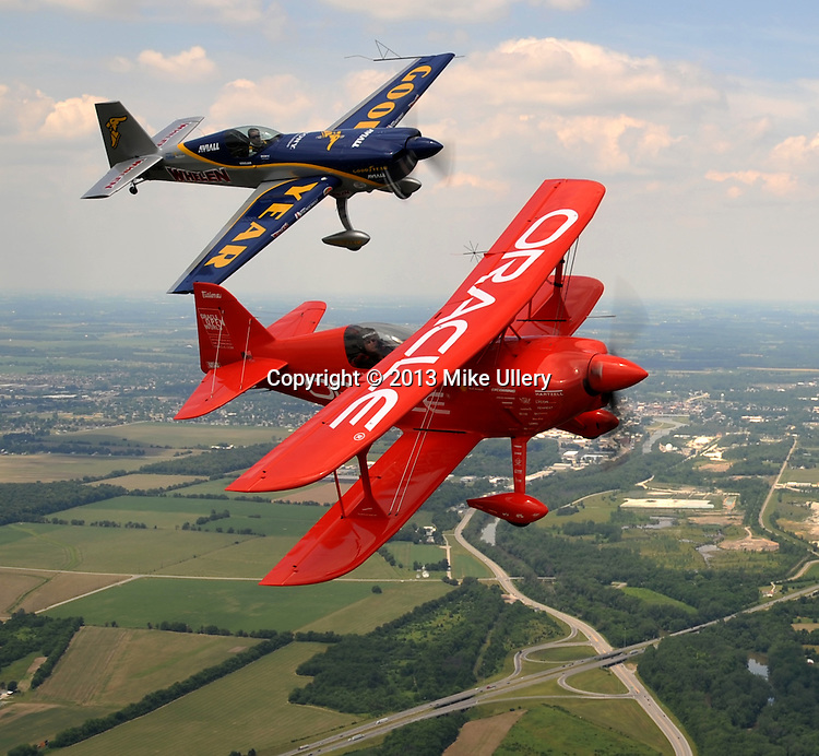 Michael Goulian and Sean D. Tucker pose for photos during a flight over Piqua and Troy on June 20, 2013. The flight was done in conjunction with the upcoming Vectren Dayton Air Show that will be held this weekend at the Dayton International Airport.