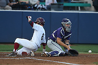 Zack Plunkett (38) of the TCU Horned Frogs waits for the ball as Austin Miller (8) the Loyola Marymount Lions scores during a game at Page Stadium on March 16, 2015 in Los Angeles, California. TCU defeated Loyola, 6-2. (Larry Goren/Four Seam Images)