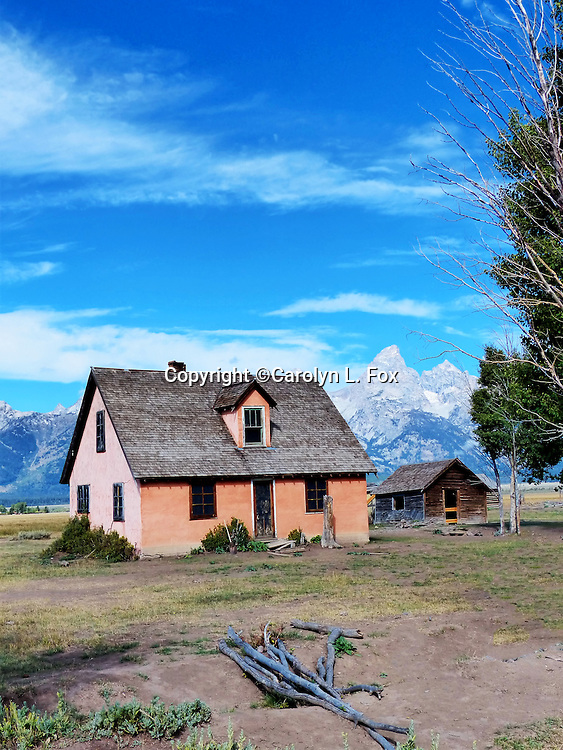 A pink cottage sits on Mormon Row outside Jackson Hole, Wyoming,