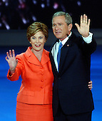 New York, NY - September 2, 2004 --  United States President George W. Bush and first lady Laura Bush on the podium after the acceptance speech at the 2004 Republican Convention in Madison Square Garden in New York, New York on Thursday, September 2, 2004.  In his remarks, the President spoke about where he wants to lead the United States for the next four years.  .Credit: Ron Sachs / CNP.(RESTRICTION: No New York Metro or other Newspapers within a 75 mile radius of New York City)