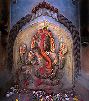 A much worshipped stone carved GANESH, the Elephant god held sacred by Buddhist & Hindu alike  - KATHMANDU, NEPAL, NEPAL