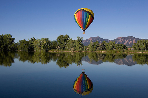Hot air balloon over lake in Boulder, Colorado. John offers private photo tours of Boulder, Denver and Rocky Mountain National Park. .  John leads private photo tours in Boulder and throughout Colorado. Year-round.