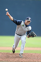 Dustin Loggins #29 of the Hillsboro Hops pitches against the Vancouver Canadians at Nat Bailey Stadium on July 24, 2014 in Vancouver, British Columbia. Hillsboro defeated Vancouver, 7-3. (Larry Goren/Four Seam Images)