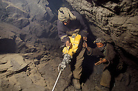 Miners digging with a Swedish pneumatic drill for the hunt of Emeralds at 4000 meters high, in the Panshir valley.