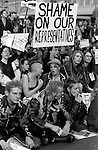 "Punks with ""shame on our representatives"" sign at Gulf War protest<br />"
