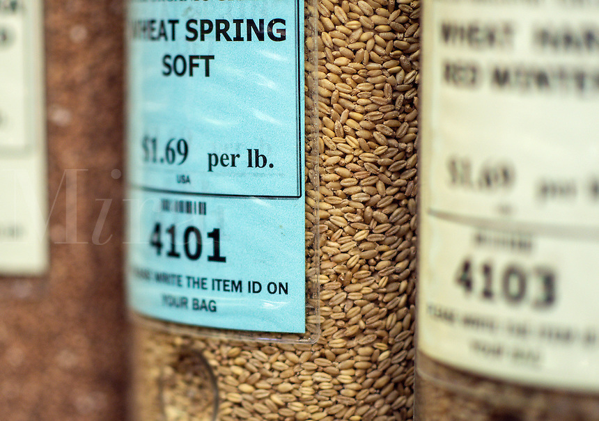 Whole organic grains in a store dispenser.