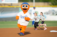 Burlington Royals mascot Bingo races young fans around the bases between innings of the game against the Bluefield Blue Jays at Burlington Athletic Stadium on June 28, 2016 in Burlington, North Carolina.  The Royals defeated the Blue Jays 4-0.  (Brian Westerholt/Four Seam Images)