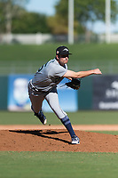 Peoria Javelinas relief pitcher Wyatt Mills (25), of the Seattle Mariners organization, follows through on his delivery during an Arizona Fall League game against the Surprise Saguaros at Surprise Stadium on October 17, 2018 in Surprise, Arizona. (Zachary Lucy/Four Seam Images)