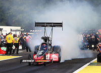 Aug. 1, 2014; Kent, WA, USA; NHRA top fuel dragster driver J.R. Todd during qualifying for the Northwest Nationals at Pacific Raceways. Mandatory Credit: Mark J. Rebilas-