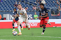 FOXBOROUGH, MA - MAY 22: Thomas Edwards #7 of New York Red Bulls approaches the New England Revolution goal with Jon Bell #22 of New England Revolution in pursuit during a game between New York Red Bulls and New England Revolution at Gillette Stadium on May 22, 2021 in Foxborough, Massachusetts.