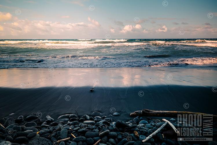 Pololu Beach with waves and rocks on the North Kohala coastline of the Big Island.