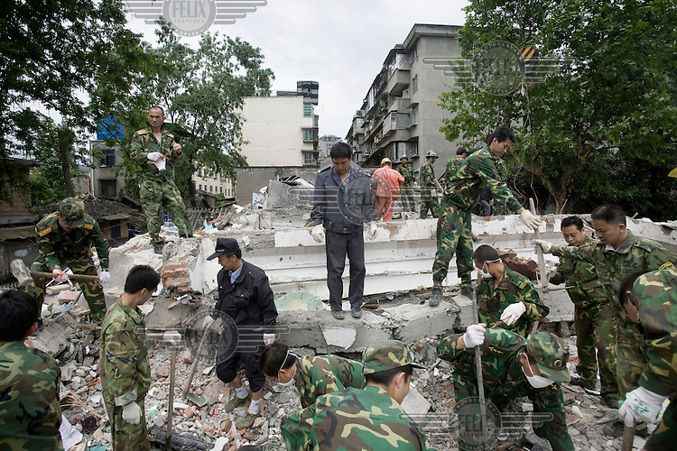 Soldiers search the rubble for survivors after the recent Sichuan earthquake of 12/05/2008, which measured 8.0 on the Richter scale. As the rescue effort goes on the death toll continues to rise.