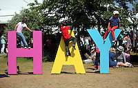HOT AND SUNNY WEATHER PICTURE WALES<br />Hay on Wye. Friday 03 June 2016<br />Three children play on the Hay sign at the Hay Festival, Hay on Wye, Wales, UK