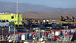 A vintage World War II-era fighter plane plunged into the grandstands Friday during a popular annual air show, killing at least three people, injuring more than 50 spectators at the Reno Air Races in Stead, Nev., on Friday, Sept. 16, 2011. (AP Photo/Cathleen Allison)