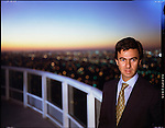 Photo Andrew Kaufman-November 1997. For NEWSWEEK. UGO Columbo an Italian Real Estate mogul poses on top of one of his building's on Miami's Brickell Avenue. Columbo is credited with creating mega real-estate in Miami. A once small town.