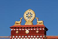 Dharmachakra, or Wheel of Law, represents the teachings of the Buddha and endless cycle of rebirth, flanked by deer atop the Jokhang Temple, Lhasa, Tibet.