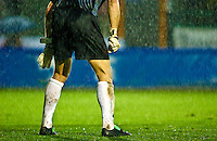 Goal keeper playing in the rain