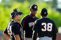 Kannapolis Intimidators starting pitcher Jefferson Olacio (center) and catcher Brent Tanner (23) listen to Kannapolis Intimidators pitching coach Jose Bautista (38) during the South Atlantic League game against the Hickory Crawdads at L.P. Frans Stadium on May 25, 2013 in Hickory, North Carolina.  The Crawdads defeated the Intimidators 14-3.  (Brian Westerholt/Four Seam Images)