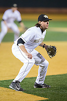 Wake Forest Demon Deacons third baseman Will Craig (22) on defense against the Georgetown Hoyas at David F. Couch Ballpark on February 19, 2016 in Winston-Salem, North Carolina.  The Demon Deacons defeated the Hoyas 3-1.  (Brian Westerholt/Four Seam Images)