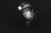 Velenje, Slovenia. Coal miner with helmet torch; RLV Mine. Black and White.