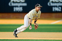 Wake Forest Demon Deacons shortstop Pat Blair (11) gets ready to flip the ball to second base during the game against the North Carolina State Wolfpack at Wake Forest Baseball Park on March 15, 2013 in Winston-Salem, North Carolina.  The Wolfpack defeated the Demon Deacons 12-6.  (Brian Westerholt/Four Seam Images)