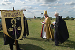 The Bishop of Norwich annual pilgrimage Rev Graham James arrives at St Benets Abbey. Brothers of St Benets with the Bishop. Gatehouse of ruined Abbey in background.