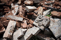 Destroyed architectural decoration lays on the ground at Gorok Nath temple in Kathmandu, Nepal