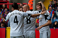 Sun 22 September 2013<br /> <br /> Pictured: Michu of Swansea andteam mates celebrate Michu's goal<br /> <br /> Re: Barclays Premier League Crystal Palace FC  v Swansea City FC  at Selhurst Park, London