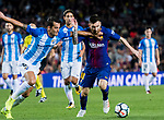 Lionel Andres Messi (r) of FC Barcelona fights for the ball with Luis Hernandez Rodriguez (l) of Malaga CF  during the La Liga 2017-18 match between FC Barcelona and Malaga CF at Camp Nou on 21 October 2017 in Barcelona, Spain. Photo by Vicens Gimenez / Power Sport Images