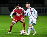 KV Kortrijk - SV Zulte-Waregem : Teddy Chevalier aan de bal voor Mustapha Oussalah.foto VDB / BART VANDENBROUCKE.