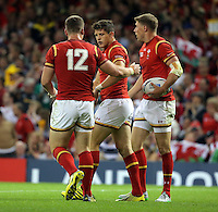 Pictured: Lloyd Williams of Wales (C) celebrates his try which was later disallowed, with team mates Scott Williams (L) and Rhys Priestland (R) Sunday 20 September 2015<br />Re: Rugby World Cup 2015, Wales v Uruguay at the Millennium, Stadium, Wales, UK