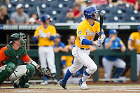 UC Santa Barbara Gauchos outfielder Andrew Calica (21) follows through on his swing against the Miami Hurricanes in Game 5 of the NCAA College World Series on June 20, 2016 at TD Ameritrade Park in Omaha, Nebraska. UC Santa Barbara defeated Miami  5-3. (Andrew Woolley/Four Seam Images)