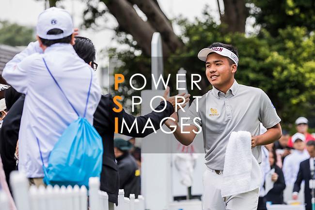 Suradit Yongcharoenchai of Thailand shakes hands with a fan during the day three of UBS Hong Kong Open 2017 at the Hong Kong Golf Club on 25 November 2017, in Hong Kong, Hong Kong. Photo by Yu Chun Christopher Wong / Power Sport Images