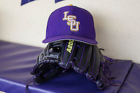 LSU Tigers hat and glove on April 24, 2015 at Alex Box Stadium in Baton Rouge, Louisiana. LSU defeated Texas A&M 9-6. (Andrew Woolley/Four Seam Images)
