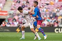 29th August 2021; Nou Camp, Barcelona, Spain; La Liga football league, FC Barcelona versus Getafe;  Clement Lenglet of FC Barcelona is held off by the Getafe player