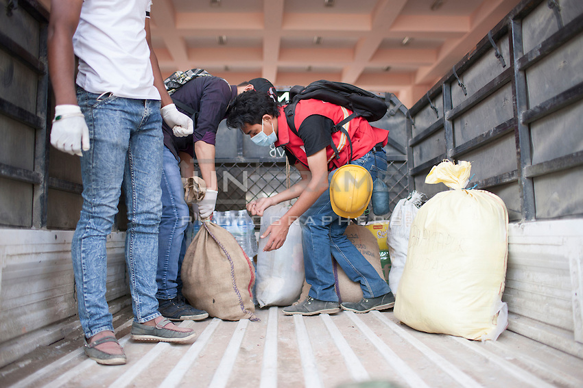 """A volunteer from """"I to We"""" loading relief goods in a vehicle in Trauma center in Kathmandu, Nepal. May 05, 2015"""
