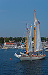 Schooner Eastwind raising sails, Boothbay Harbor, Maine, USA