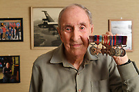 BNPS.co.uk (01202) 558833<br /> Pic: ZacharyCulpin/BNPS<br /> <br /> Pictured: Ken Symonds with the medals, Ken's Bomber command clasp 75 (second left).<br /> <br /> An RAF veteran who flew the last Lancaster bomber home on the final sortie of the war has finally received his Bomber Command clasp 75 years later.<br /> <br /> Former Squadron Leader Ken Symonds, 97, limped his aircraft back to Britain following the last big raid of Bomber Command's Europe offensive.<br /> <br /> The sortie took place over Berchestgaden, the town in the Bavarian Alps where Adolf Hitler had his Eagles Nest retreat, on April 25, 1945 - five day's before the evil dictator's suicide.<br /> <br /> The Lancaster was struck by anti-aircraft fire which resulted in one of its four engines to be knocked out.