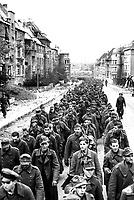 The endless procession of German prisoners captured with the fall of Aachen marching through the ruined city streets to captivity.  Germany, October 1944.  Associated Press Ltd.  (U.S. Occupation Headquarters)<br /> Exact Date Shot Unknown<br /> NARA FILE #:  260-MGG-1061-1<br /> WAR & CONFLICT BOOK #:  1290
