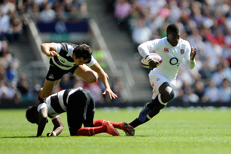 Christian Wade of England leaves Timoci Nagusa (floor) and Rowan Varty of the Barbarians in a tangle during the match between England and Barbarians at Twickenham on Sunday 26th May 2013 (Photo by Rob Munro)