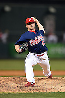Memphis Redbirds pitcher Justin Wright (61) delivers a pitch during a game against the Oklahoma City RedHawks on May 23, 2014 at AutoZone Park in Memphis, Tennessee.  Oklahoma City defeated Memphis 12-10.  (Mike Janes/Four Seam Images)