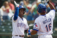Round Rock Express shortstop Jurickson Profar #10 is greeted by teammate Joey Butler #16 after he blasted a grand slam home run the seventh inning of the Pacific Coast League baseball game against the New Orleans Zephyrs in the on April 21, 2013 at the Dell Diamond in Round Rock, Texas. Round Rock defeated New Orleans 7-1. (Andrew Woolley/Four Seam Images)